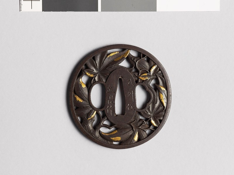 Tsuba with branches and leaves from a maple tree
