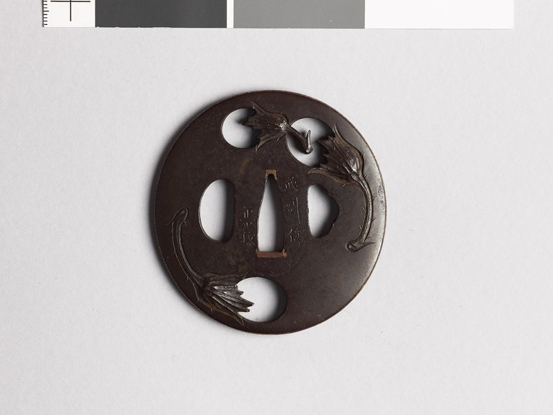 Lenticular tsuba with egg fruits