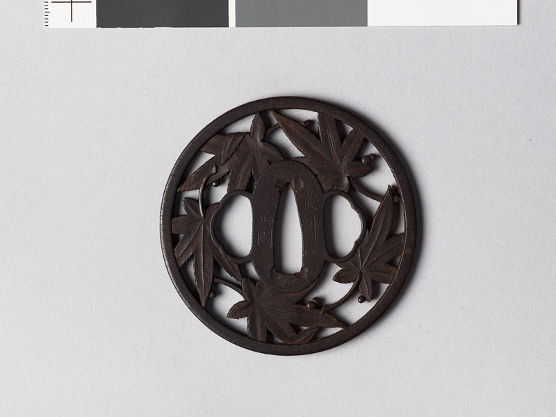 Round tsuba with maple leaves