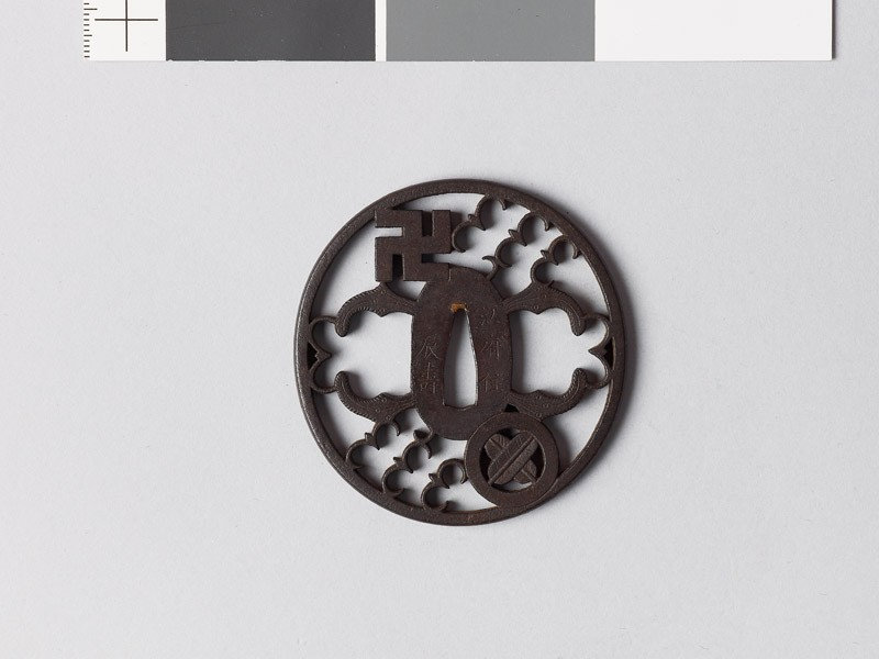 Tsuba with mon of swastika and hawk feathers