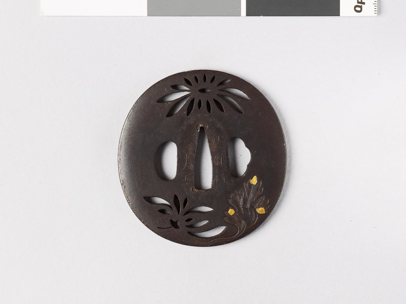 Lenticular tsuba with chrysanthemum flowers and leaves