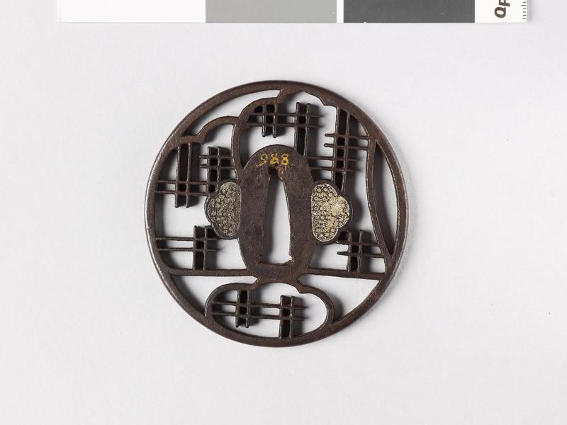 Round tsuba with lattice work