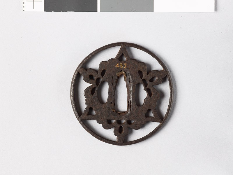 Round tsuba with triangle and flowers (front           )