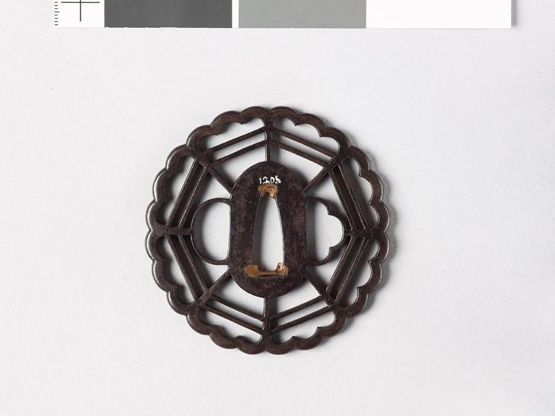 Tsuba with chrysanthemoid border enclosing a cobweb shape (front           )