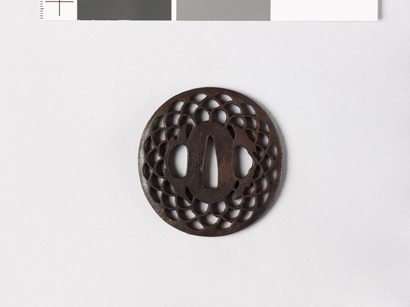 Lenticular tsuba with diaper of overlapping chrysanthemum flowers and leaves