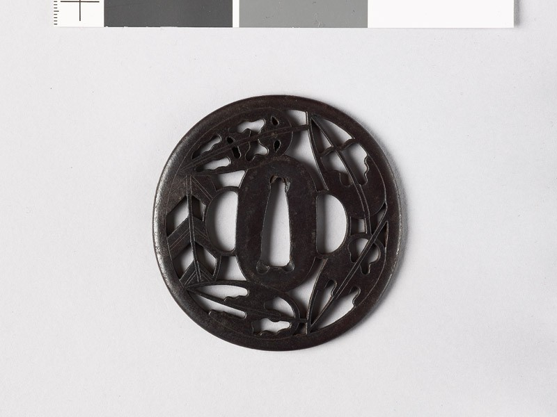 Tsuba with heraldic hawk feathers and ground bamboo