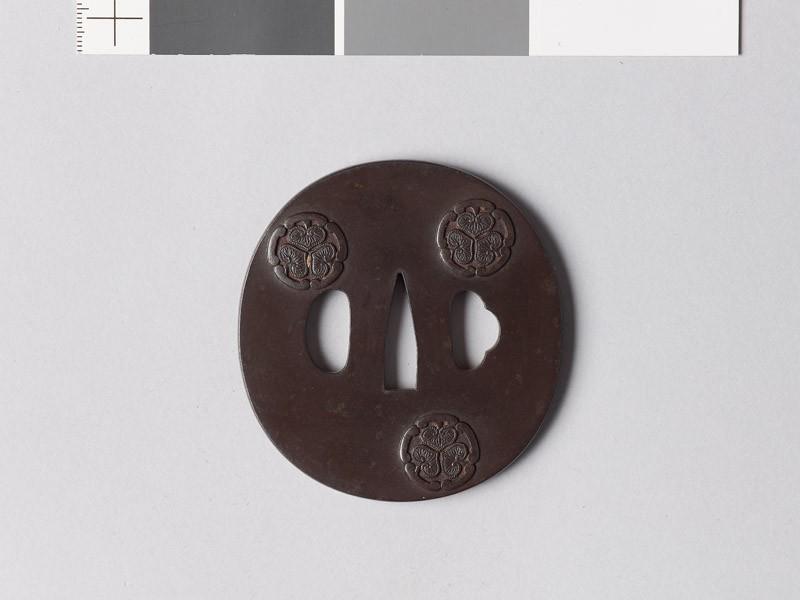 Tsuba with kwan-wa ni mitsu-aoi mon, comprising wild ginger inside drawer handles (EAX.10718, front           )