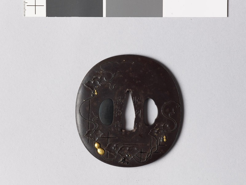 Lenticular tsuba with gourds on a vine