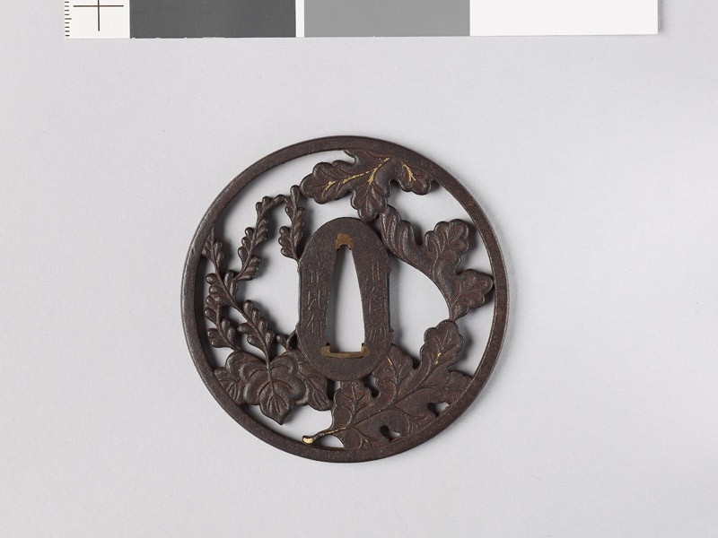 Round tsuba with chrysanthemum leaves and mon made from kiri, or paulownia leaves (EAX.10748, front           )