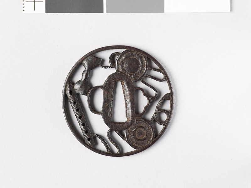 Round tsuba with six-holed flute and parts of a hand drum (EAX.10767, front           )