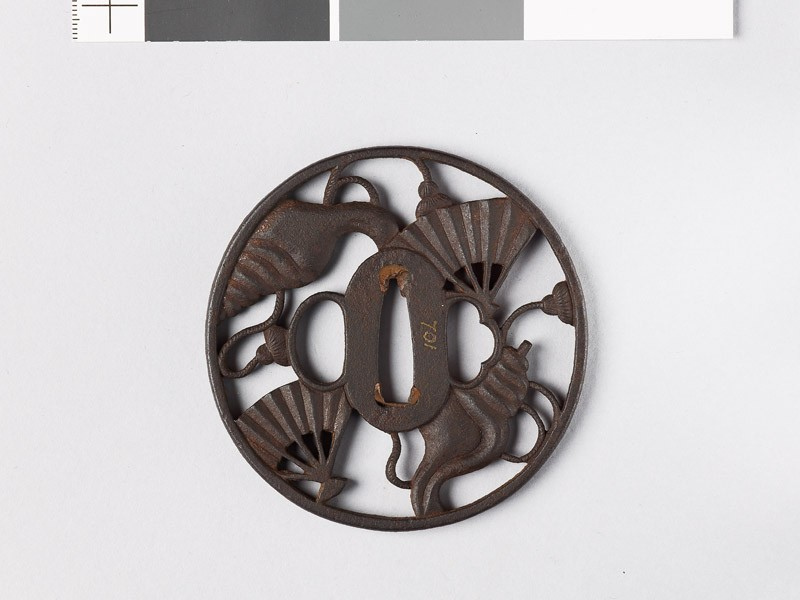 Round tsuba with conch shells and war fans (EAX.10778, front           )