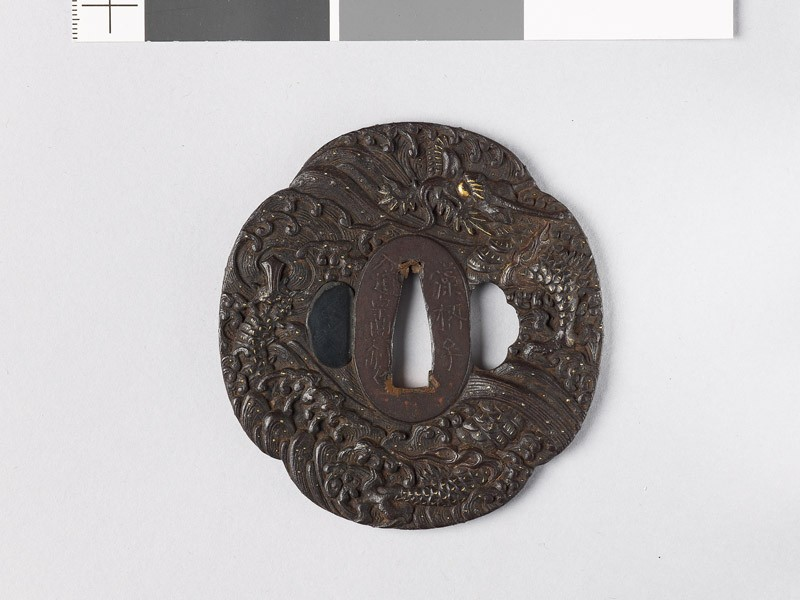 Mokkō-shaped tsuba with a dragon emerging from waves (EAX.10784, front           )