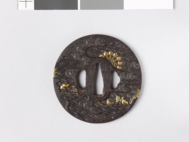 Tsuba with egrets, men in boats, and a water wheel