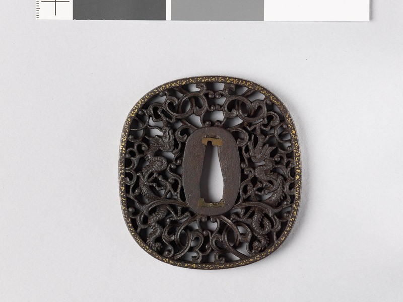 Tsuba with two dragons amid karakusa, or scrolling plant pattern (front           )