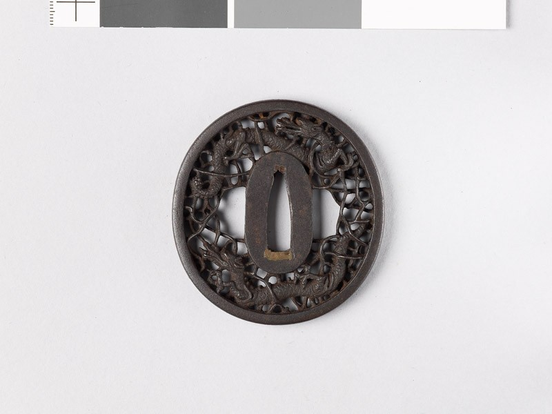 Tsuba with two dragons amid karakusa, or scrolling plant pattern (EAX.10798, front           )