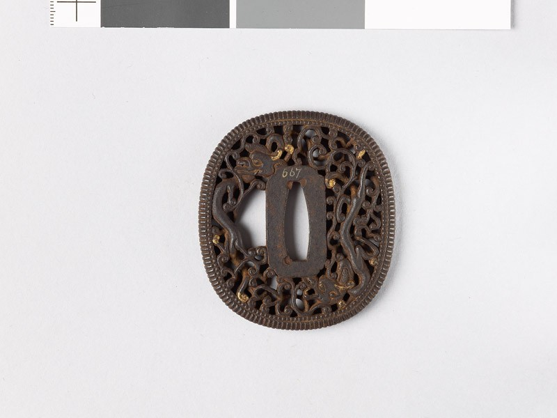 Tsuba with dragon amid scrollwork (front           )