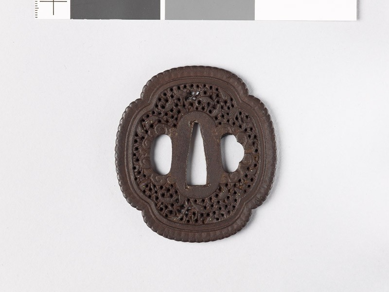 Mokkō-shaped tsuba with scrollwork and fish (EAX.10807, front           )