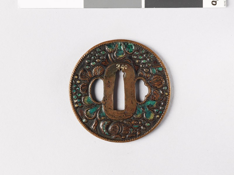 Tsuba with squirrel amid vines (front           )