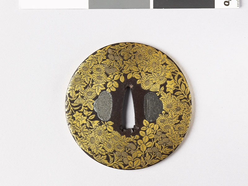 Round tsuba with asters, lespedeza, and gentian