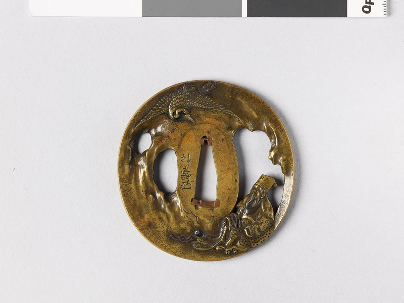 Tsuba depicting the god of luck Jurōjin, with his familiar (front           )