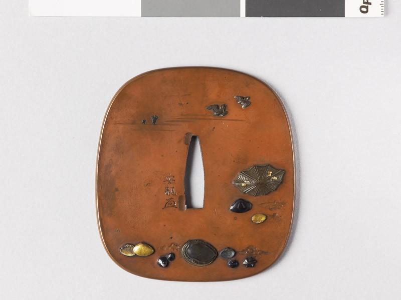 Aori-shaped tsuba with sea shells and flying birds