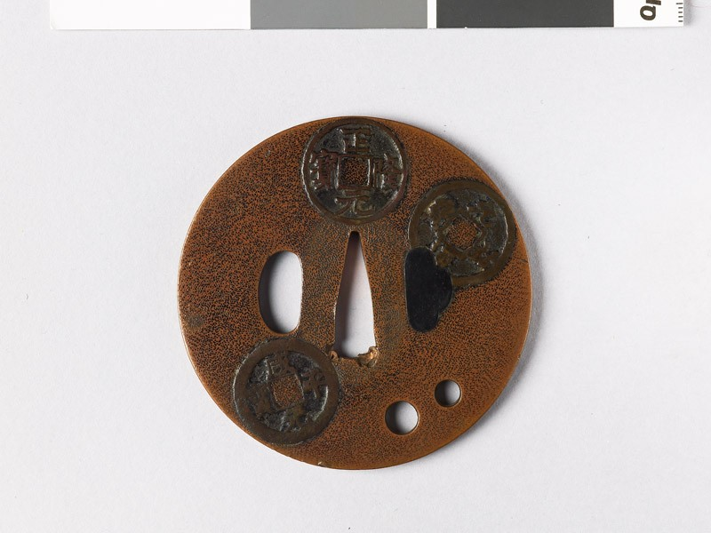 Round tsuba with Chinese coins