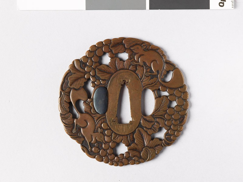 Mokkō-shaped tsuba with vine and squirrels (EAX.10963, front           )