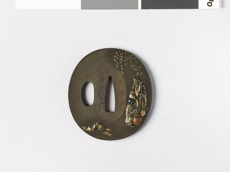 Tsuba depicting the Chinese sage Lin Ho-ch'ing pouring wine
