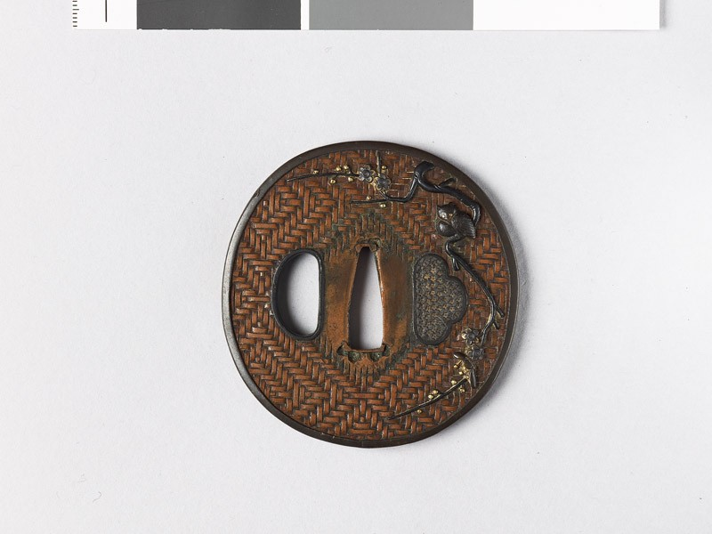 Tsuba with owl perched on a plum branch