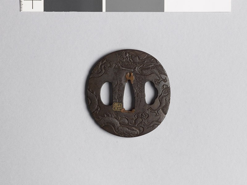 Lenticular tsuba with two dragons (front           )