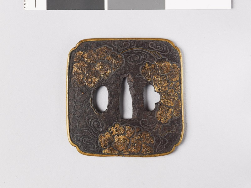 Lenticular tsuba with peony flowers (front           )