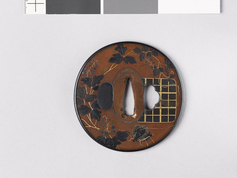 Tsuba with flowering vine and butterfly (front           )
