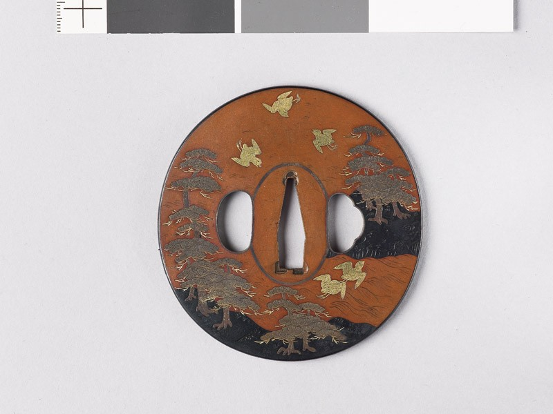Tsuba depicting birds flying above Matsushima