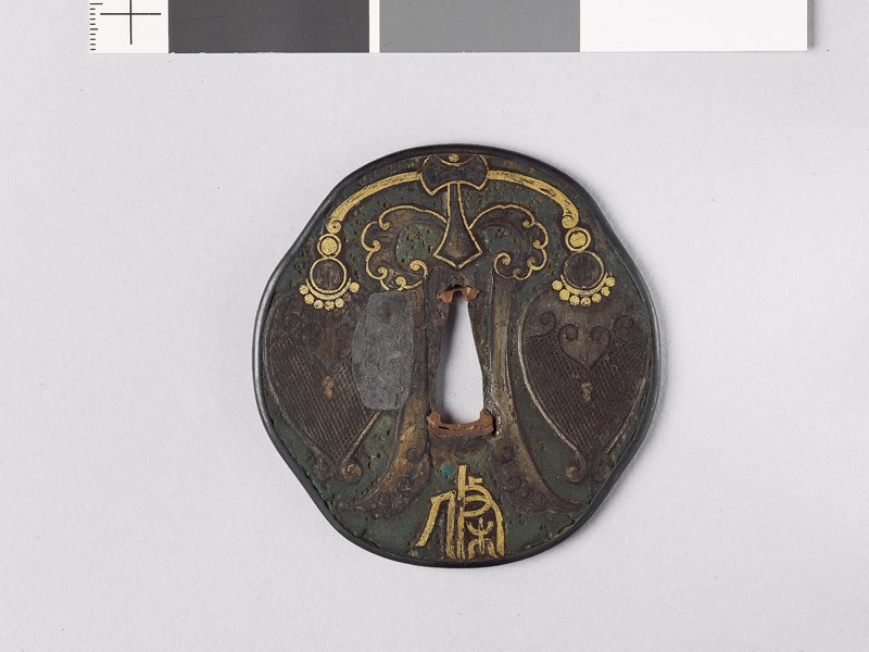 Octagonal tsuba with Chinese pendent
