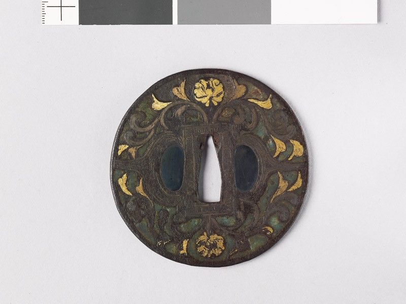 Round tsuba with flowers, foliage, and dragons (front           )