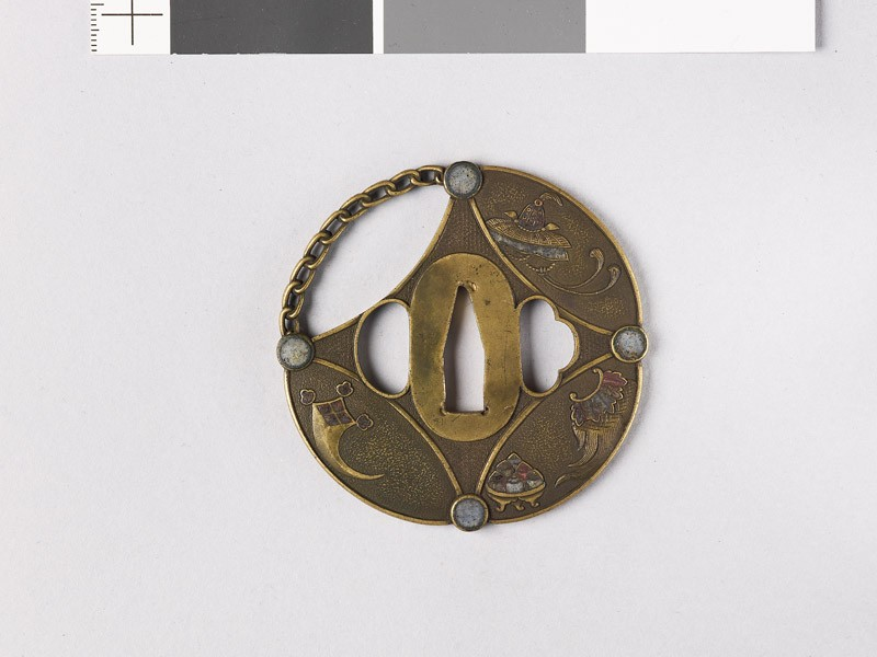 Round tsuba in the form of a shippō diaper, with Luck Objects