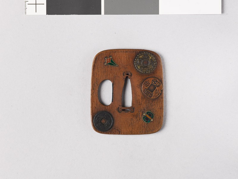 Aori-shaped tsuba depicting charms, coins, and three of the Seven Treasures (EAX.11166, front           )
