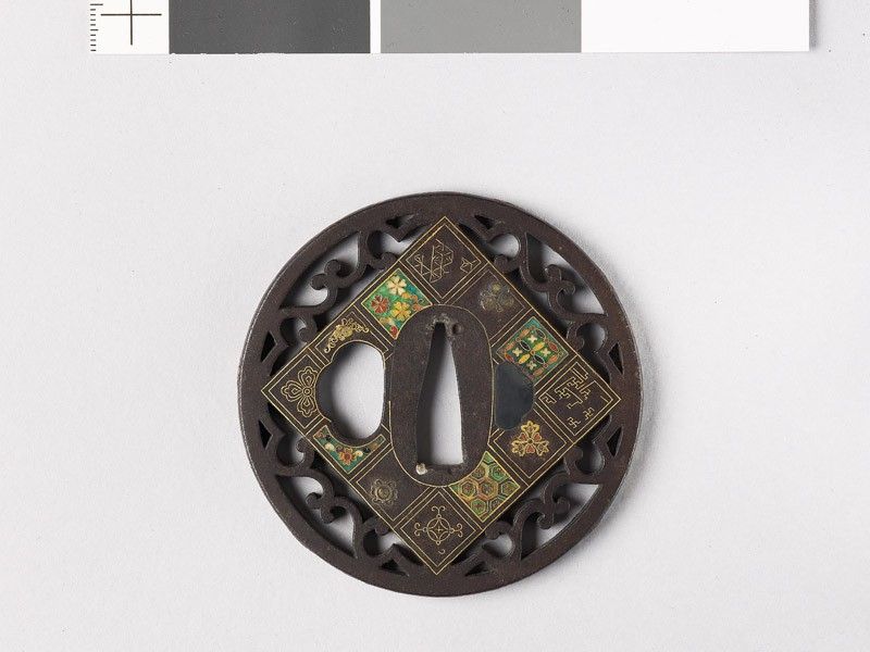 Round tsuba with flowers and scrolls (EAX.11172, front           )