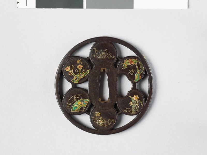 Round tsuba with trees and flowers