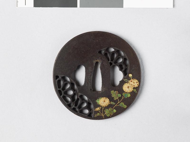 Round tsuba with chrysanthemum mon