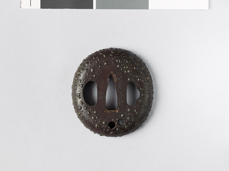 Tsuba with gama-hada, or toad skin, surface