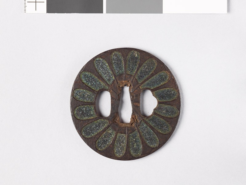 Tsuba with chrysanthemoid florets and sword-blades
