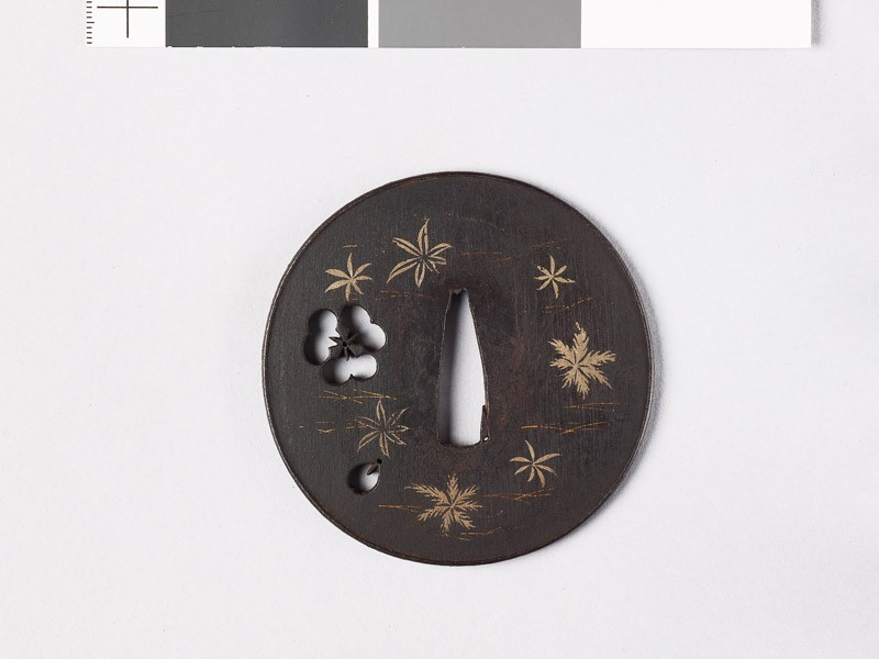 Lenticular tsuba with petals and leaves
