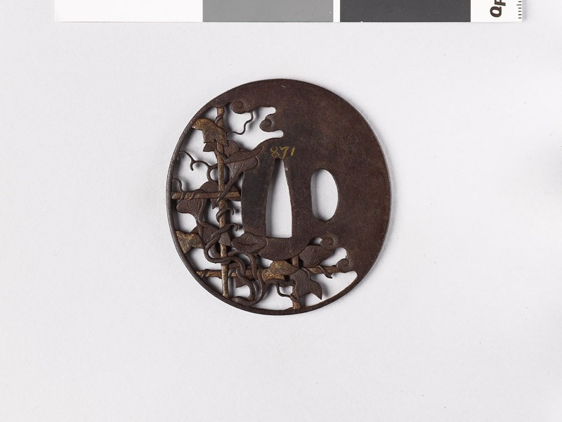 Tsuba with morning glory growing over a bamboo lattice (front           )