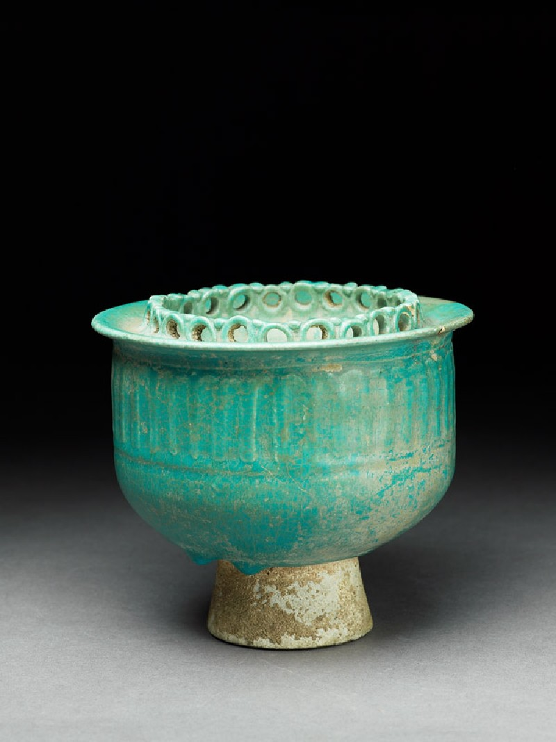 Cup with pierced decoration and small mouth