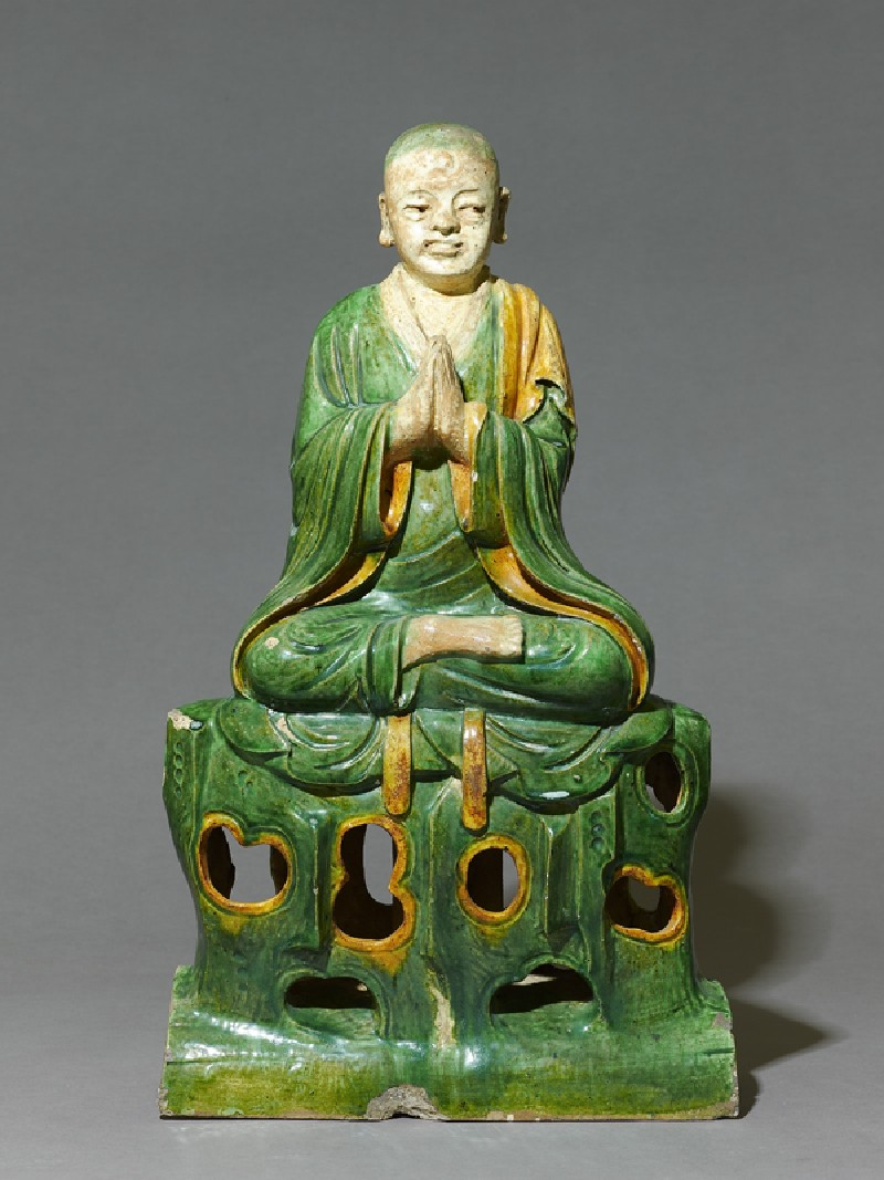 Roof ridge tile in the form of a seated Buddhist figure (front          )