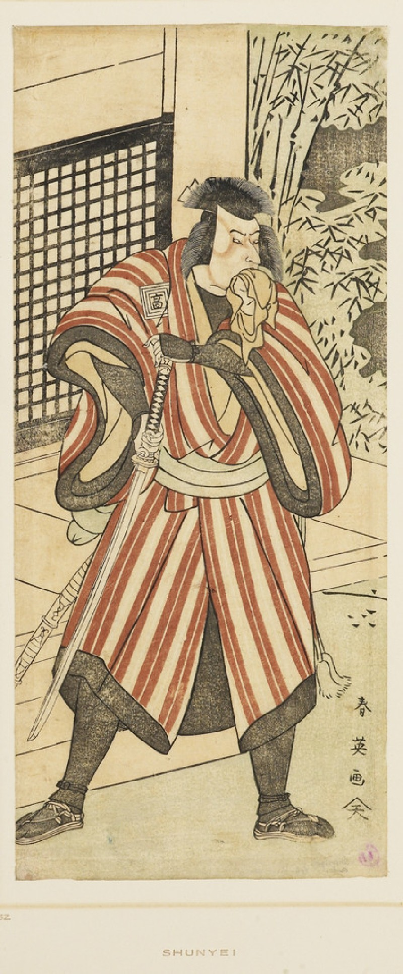 Ichikawa Komazō II in winter clothing holding a drawn sword and with a handerkerchief in his mouth
