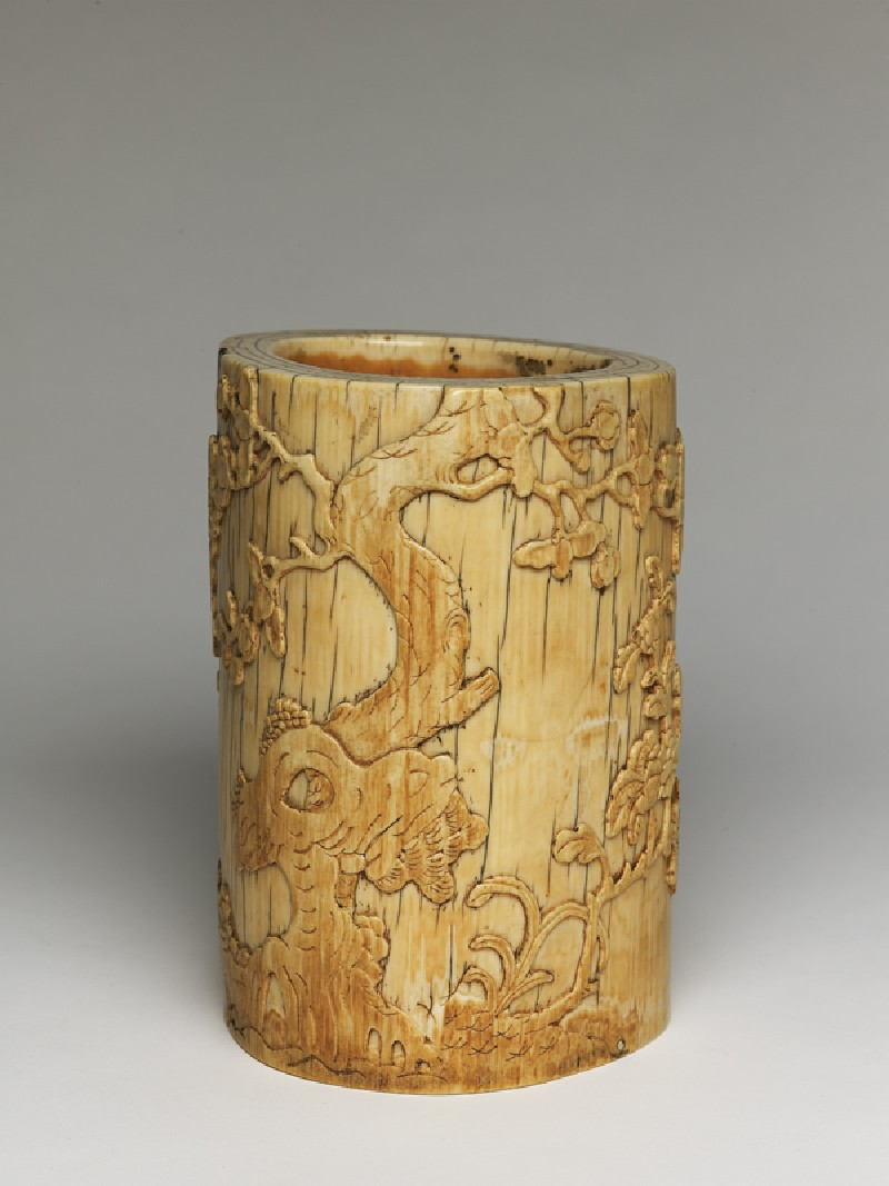 Ivory brush-pot with plum blossoms and a poem