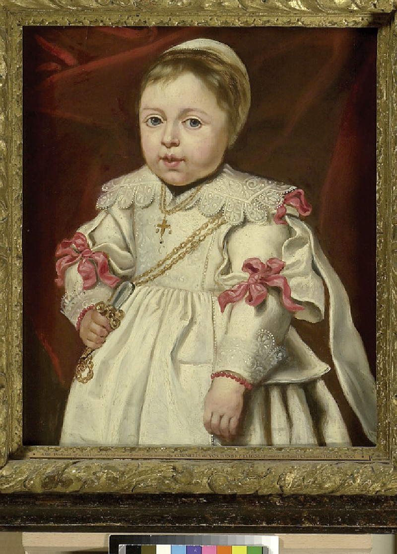 Portrait of a Child holding a Rattle