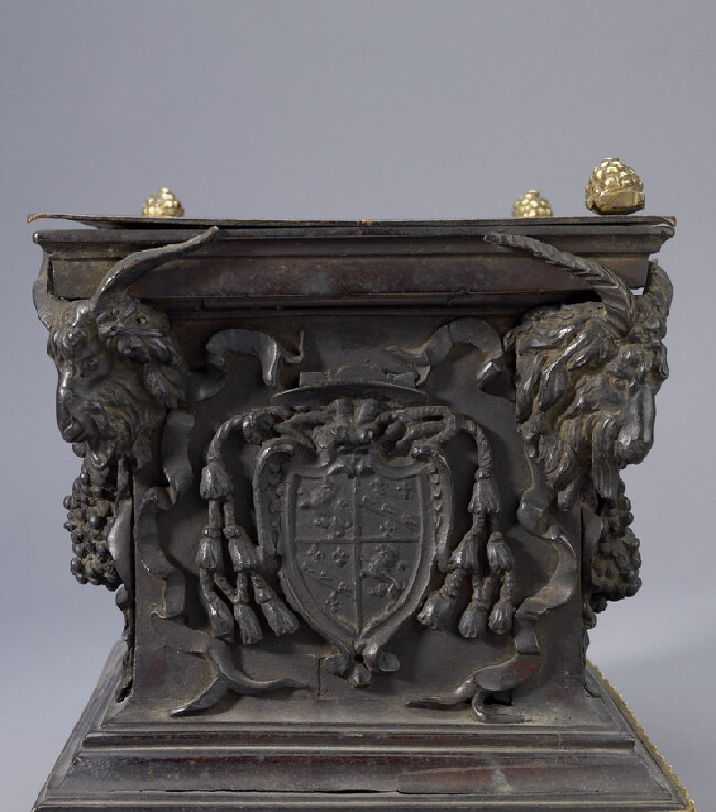 Pedestal ornamented with swags and the heads of lions and goats